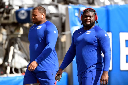 New York Giants defensive linemen Dalvin Tomlinson, right, and Dexter Lawrence II walk the field before the game. The New York Giants host the Washington Redskins in NFL Week 4 on Sunday, Sept. 29, 2019, in East Rutherford.