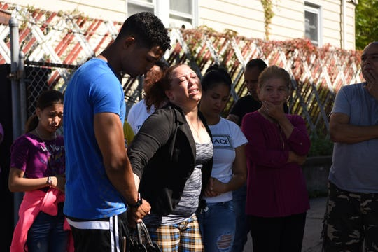 Friends and relatives arrive at the scene of an alleged murder-suicide on E 16th St. in Paterson near Lyon St. on September 29, 2019.