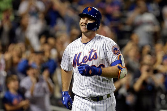 New York Mets' Pete Alonso reacts after hitting his 53rd home run of the season during the third inning of a baseball game against the Atlanta Braves, Saturday, Sept. 28, 2019, in New York. It set the MLB record for rookie home runs in a single season.