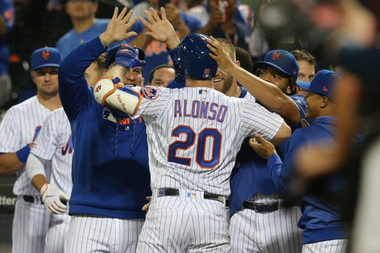Sep 28, 2019; New York City, NY, USA; New York Mets first baseman Pete Alonso (20) celebrates after hitting a solo home run against the Atlanta Braves during the third inning at Citi Field. The home run was his 53rd of the season breaking the rookie record for home runs in a single season.