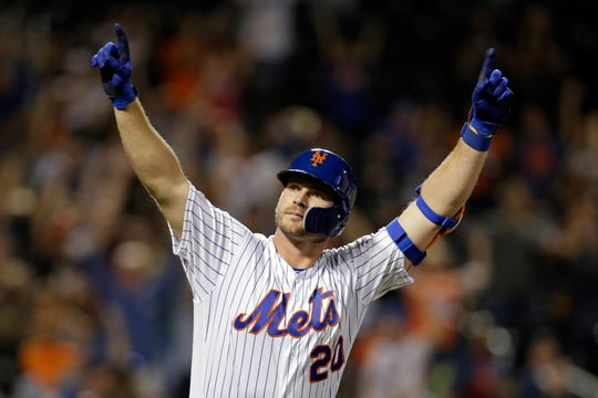 New York Mets' Pete Alonso reacts after hitting his 53rd home run of the season during the third inning of a baseball game against the Atlanta Braves, Saturday, Sept. 28, 2019, in New York.