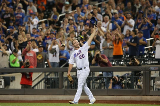 Sep 28, 2019; New York City, NY, USA; New York Mets first baseman Pete Alonso (20) celebrates his third inning solo home run against the Atlanta Braves as he comes onto the field for the fourth inning at Citi Field. The home run was his 53rd of the season breaking the rookie record for home runs in a single season.