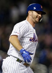 New York Mets Pete Alonso reacts after hitting his 53rd home run of the season during the third inning of a baseball game against the Atlanta Braves on Saturday, Sept. 28, 2019, in New York. It set the MLB record for rookie home runs in a single season.