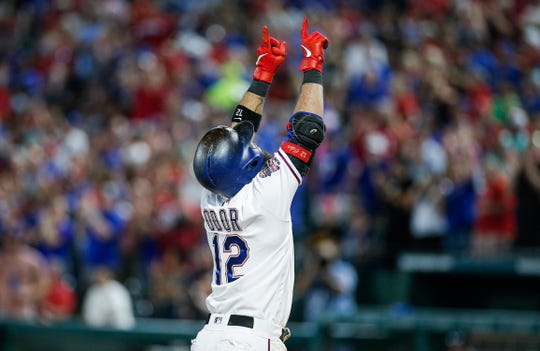 Texas Rangers' Rougned Odor points skyward after hitting a grand slam during the sixth inning of a baseball game against the New York Yankees, Saturday, Sept. 28, 2019, in Arlington, Texas.