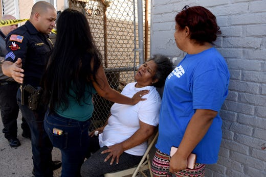 Ylumiada Ramires, seated, the mother of murder victim Estafani Hernandez, is inconsolable at the scene of the apparent murder-suicide, in which her daughter was killed on E 16th St. in Paterson near Lyon St. on September 29, 2019.