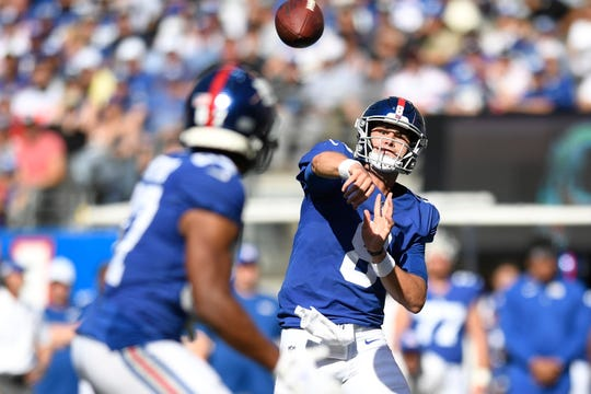 New York Giants quarterback Daniel Jones, right, throws to wide receiver Sterling Shepard, left, in the second half. The Giants defeat the Redskins, 24-3, in NFL Week 4 on Sunday, Sept. 29, 2019, in East Rutherford.