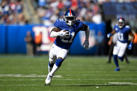 New York Giants safety Jabrill Peppers (21) runs for a touchdown after intercepting a pass from Washington Redskins quarterback Dwayne Haskins (not pictured) in the second half. The Giants defeat the Redskins, 24-3, in NFL Week 4 on Sunday, Sept. 29, 2019, in East Rutherford.