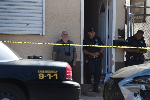 Law enforcement investigate an apparent apparent murder-suicide at 263 E. 16th St. in Paterson near Lyon St. on September 29, 2019.