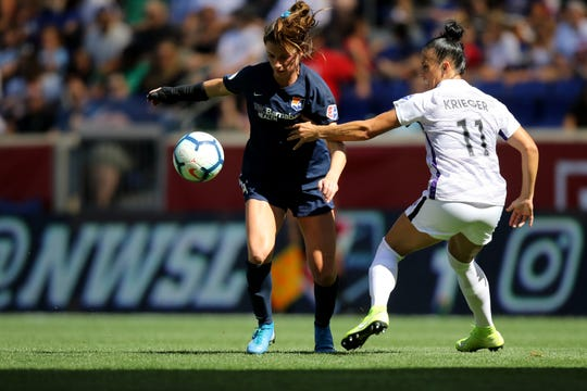 Paige Monaghan, of Sky Blue FC, moves past Ali Krieger, of the Orlando Pride. Sunday, September 29, 2019