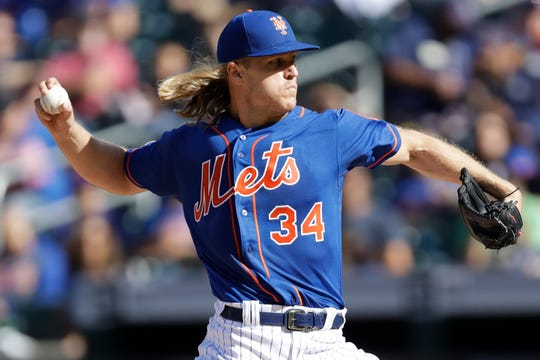 New York Mets starting pitcher Noah Syndergaard winds up during the first inning of a baseball game against the Atlanta Braves, Sunday, Sept. 29, 2019, in New York. (AP Photo/Kathy Willens)