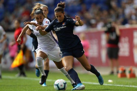 Carli Lloyd, of Sky Blue FC and Marta, of the Orlando Pride, race towards the ball.  Sunday, September 29, 2019