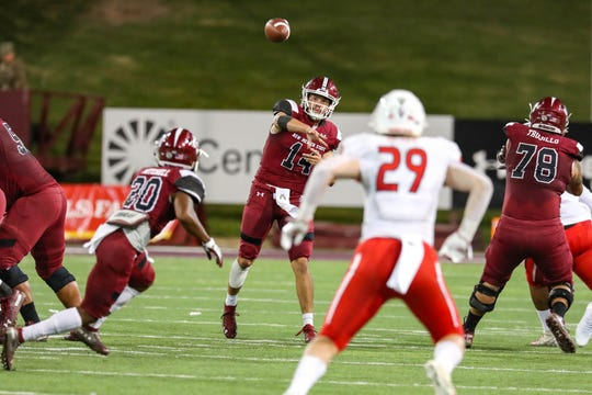 NMSU redshirt sophomore quarterback Josh Adkins (14) passes the ball as New Mexico State University Aggies face off against the Fresno State Bulldogs at Aggie Memorial Stadium in Las Cruces on Saturday, Sept. 28, 2019.