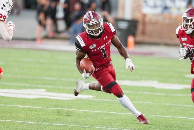 NMSU senior running back Jason Huntley (1) runs the ball as New Mexico State University Aggies face off against the Fresno State Bulldogs at Aggie Memorial Stadium in Las Cruces on Saturday, Sept. 28, 2019.
