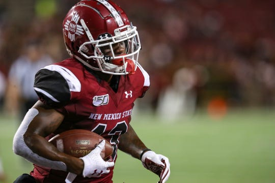 NMSU graduate student wide receiver Tony Nicholson (13) scores as New Mexico State University Aggies face off against the Fresno State Bulldogs at Aggie Memorial Stadium in Las Cruces on Saturday, Sept. 28, 2019.