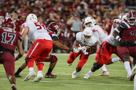 Fresno State junior running back Ronnie Rivers (20) runs the ball as New Mexico State University Aggies face off against the Fresno State Bulldogs at Aggie Memorial Stadium in Las Cruces on Saturday, Sept. 28, 2019.