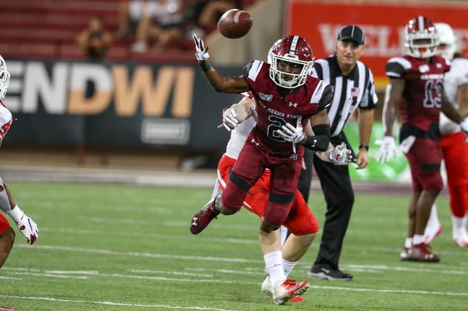 NMSU redshirt senior wide receiver OJ Clark (2) attempts to receive as pass that is intercepted as New Mexico State University Aggies face off against the Fresno State Bulldogs at Aggie Memorial Stadium in Las Cruces on Saturday, Sept. 28, 2019.