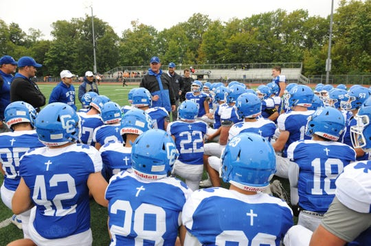 Detroit Catholic Central head coach Dan Anderson addresses his team after the Shamrocks defeat Brother Rice 7-3 on Sept. 29.