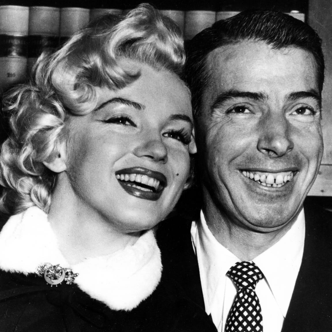 Joe Dimaggio, Baseball's famed 'Yankee Clipper' and actress Marilyn Monroe, smile cheek to cheek as they wait patiently in Judge Charles Perry's chambers for their marriage ceremony in san Francisco, CA., USA, January 14, 1954. The wedding climaxed a romance of more than a year.