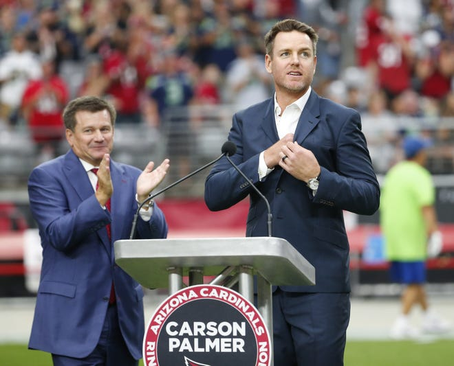 Former Arizona Cardinals quarterback Carson Palmer prepares to address the crowd during his Ring of Honor induction ceremony during halftime against the Seattle Seahawks September 29, 2019.