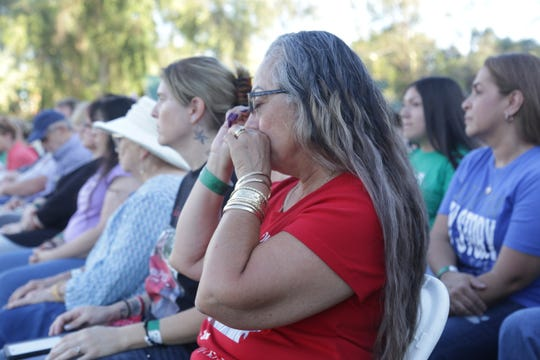 Kathy Gallegos, whose son was murdered at a McDonald's in Phoenix in February, becomes emotional while attending an annual event held for families who have lost loved ones to violence on Sept. 28, 2019.