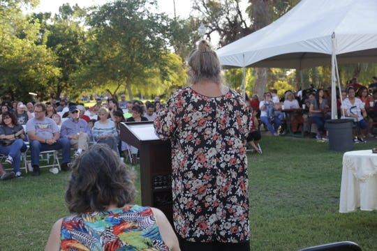 Beckie Miller, who leads Arizona's chapter of Parents of Murdered Children, addresses a crowd of over 400 at Encanto Park on Sept. 28, 2019.
