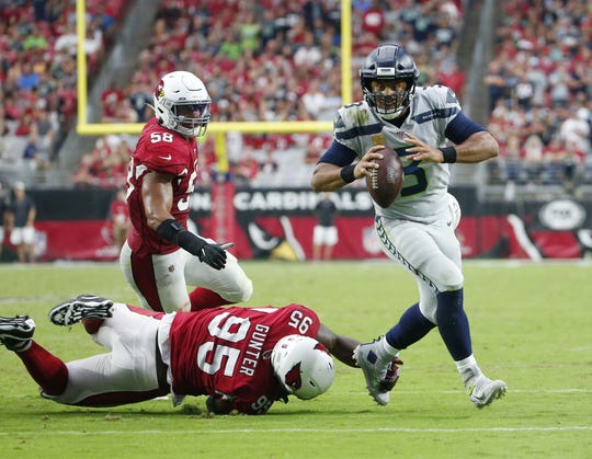 Seattle Seahawks quarterback Russell Wilson (3) breaks away from pressure by Arizona Cardinals outside linebacker Terrell Suggs (56) during the fourth quarter September 29, 2019.