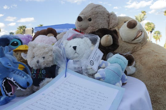 Teddy bears to be raffled off sit on a table at the annual event hosted by Arizona's chapter of People of Murdered Children, Inc. at Encanto Park on Sept. 28, 2019.