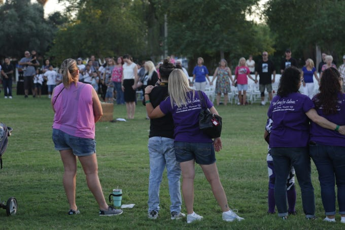 Families of loved ones lost to violence comfort one another during a dove release ceremony held at Encanto Park on Sept. 28, 2019.