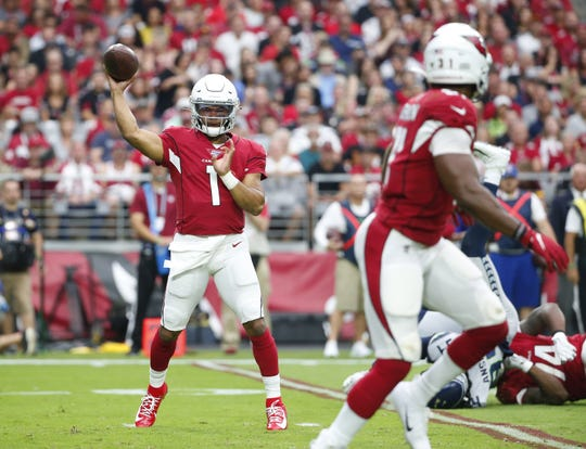 Arizona Cardinals quarterback Kyler Murray (1) throws a pass to running back David Johnson (31) during the first quarter against the Seattle Seahawks September 29, 2019.
