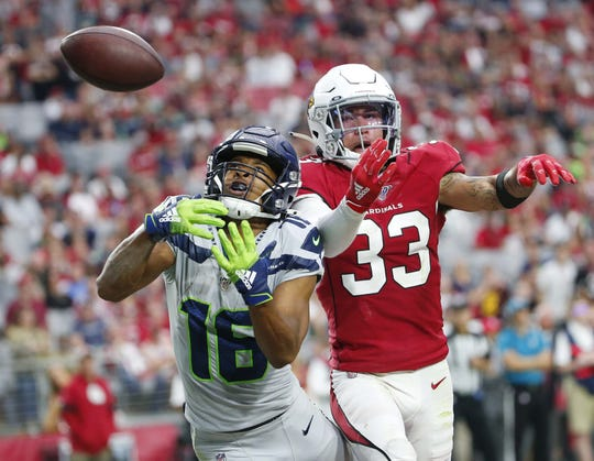 Arizona Cardinals cornerback Byron Murphy (33) breaks up a pass intended for Seattle Seahawks wide receiver Tyler Lockett (16) during the fourth quarter September 29, 2019.