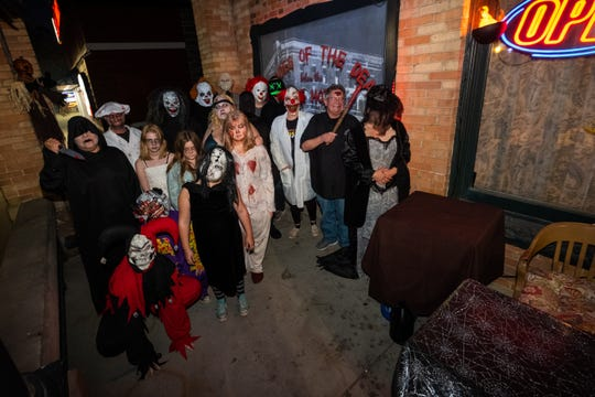Costumed actors assemble on the front porch of the Yale Hotel before opening Decades of the Dead, a haunted attraction held in the hotel's basement, Saturday, Sept. 28, 2019.