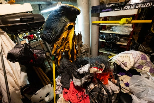 Different masks and props are piled up in the actor's dressing room at Decades of the Dead at the Yale Hotel.