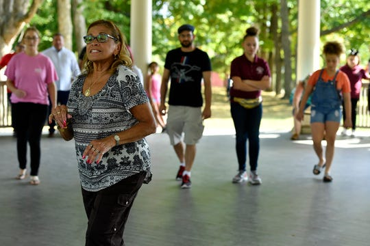 Loida Esbri of Lancaster gives a free basic salsa dance lesson during Salsa in the Park at Farquhar Park, Sunday, September 29, 2019.John A. Pavoncello photo