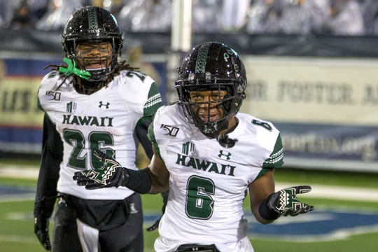 Hawaii wide receiver Cedric Byrd II (6) reacts after scoring a  touchdown against Nevada on Saturday night at Mackay Stadium.