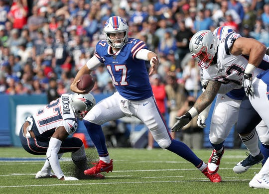 Bills quarterback Josh Allen is flushed out of the pocket against the Patriots.