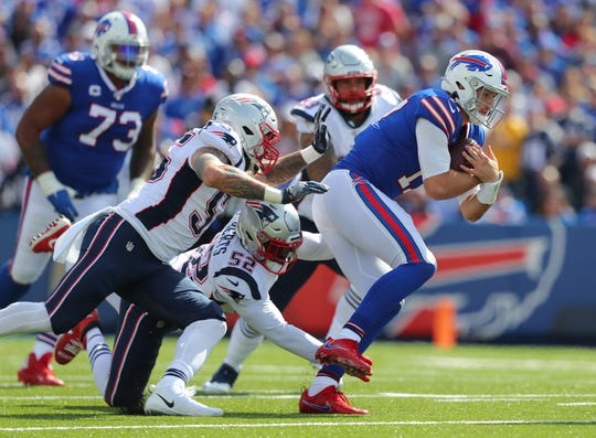 ORCHARD PARK, NY - SEPTEMBER 29:  John Simon #55 of the New England Patriots and Elandon Roberts #52 of the New England Patriots try to tackle Josh Allen #17 of the Buffalo Bills during the first half at New Era Field on September 29, 2019 in Orchard Park, New York.  (Photo by Timothy T Ludwig/Getty Images)