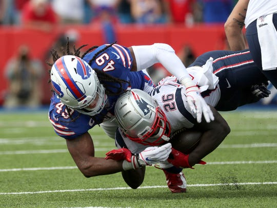 Bills linebacker Tremaine Edmunds drives Patriots running back Sony Michel into the ground after a short gain.