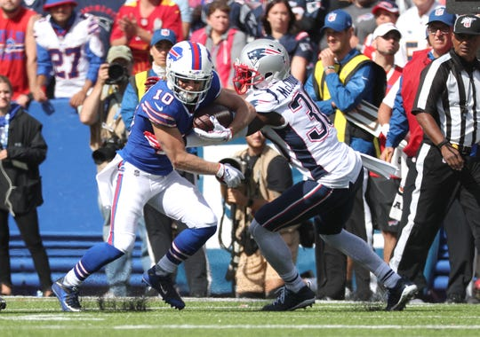 Bills receiver Cole Beasley looks for extra yards against Patriots Jason McCourty.