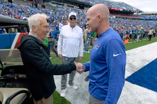 Former Buffalo Bills head coach Marv Levy, left, speaks to current head coach Sean McDermott, right, before an NFL football game between the Bills and the New England Patriots Sept. 29, 2019 in Orchard Park.