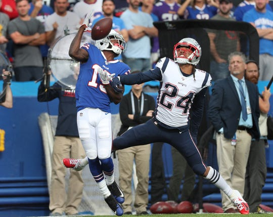 Bills receiver John Brown makes a one-handed catch behind former Bills player Stephon Gilmore.