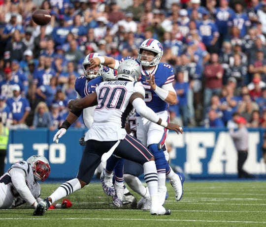 Bills quarterback Matt Barkley steps into this throw against the Patriots.