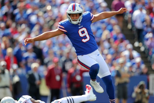 ORCHARD PARK, NY - SEPTEMBER 29:  Corey Bojorquez #9 of the Buffalo Bills reacts after his punt gets blocked during the first half against the New England Patriots at New Era Field on September 29, 2019 in Orchard Park, New York.  (Photo by Timothy T Ludwig/Getty Images)