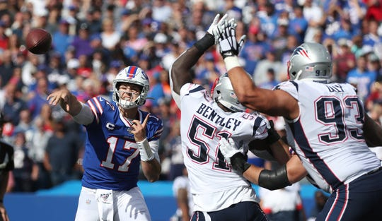 Bills quarterback Josh Allen was pressured much of the day against the Patriots.