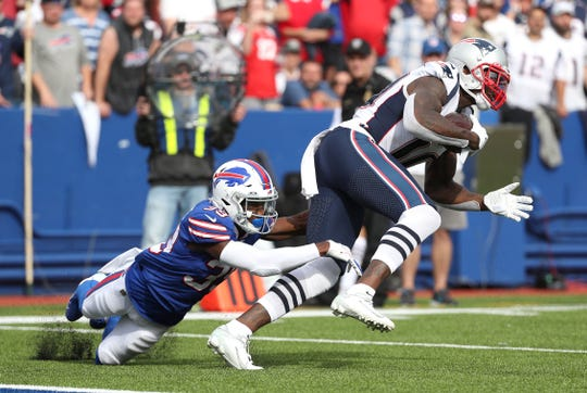 Buffalo Bills cornerback Levi Wallace  makes a tackle on the Patriots Josh Gordon.