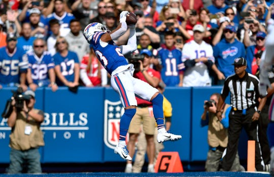 Buffalo Bills safety Micah Hyde intercepts a pass in the end zone, thrown by New England Patriots quarterback Tom Brady, in the first half of an NFL football game, Sunday, Sept. 29, 2019, in Orchard Park, N.Y. (AP Photo/Adrian Kraus)