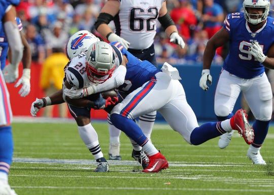 ORCHARD PARK, NY - SEPTEMBER 29:  Tremaine Edmunds #49 of the Buffalo Bills makes a tackle on James White #28 of the New England Patriots as he runs the ball during the second half at New Era Field on September 29, 2019 in Orchard Park, New York.  Patriots beat the Bills 16 to 10. (Photo by Timothy T Ludwig/Getty Images)