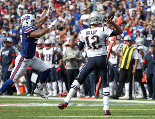Patriots quarterback Tom Brady is pressured by the Bills' Lorenzo Alexander.