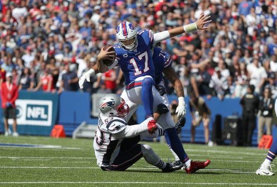 Bills quarterback Josh Allen is sacked by Patriots Kyle Van Noy.