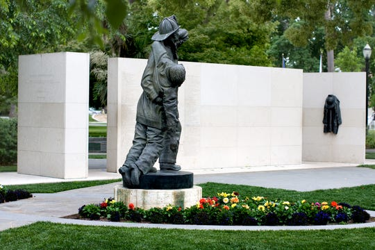 The names of two former Redding Fire Department firefighters were added to the California Fallen Firefighters Memorial Wall in Sacramento this past weekend.
