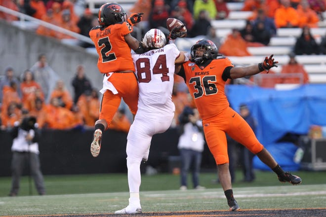 Sep 28, 2019; Corvallis, OR, USA; Oregon State Beavers defensive back Shawn Wilson (2) and Oregon State Beavers linebacker Omar Speights (36) break up a pass to Stanford Cardinal tight end Colby Parkinson (84) in the second half at Reser Stadium. Mandatory Credit: Jaime Valdez-USA TODAY Sports